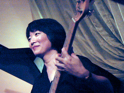 Close-up of Stephanie Lee, bass player with Lowell James Hicks