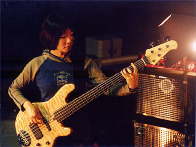 Stephanie Lee playing bass with Lowell James Hicks